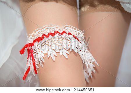Garter Bride.Wedding day, bride's attributes, wedding dress