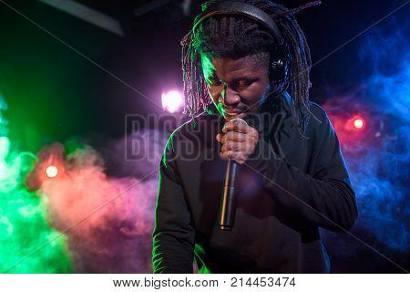 Dj In Headphones With Microphone