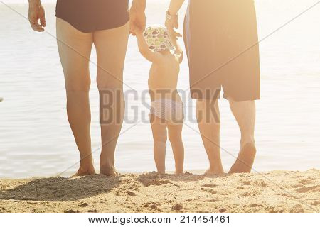 Happy Family Outdoors. A Family Of Two Dads And A Daughter On The Beach. Men Fathers And Children. P