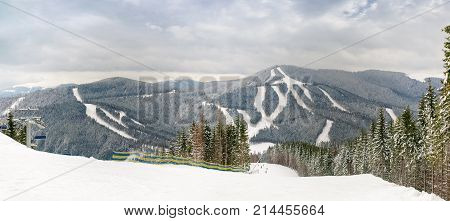 Panorama of part of the ski resort in Carpathian Mountains in cloudy day Ukraine