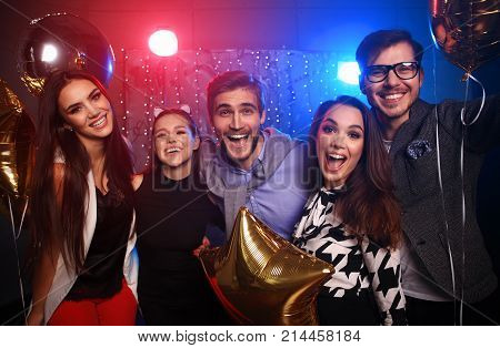 new year party, holidays, celebration, nightlife and people concept - Young people having fun dancing at a party.