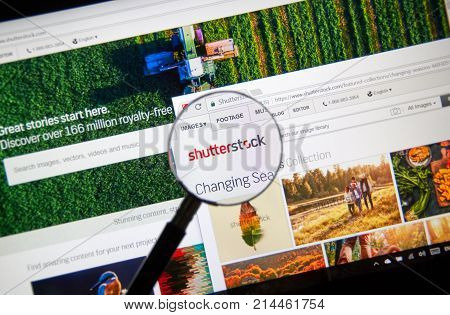 MONTREAL CANADA - NOVEMBER 7 2017: Shutterstock homepage and logo under magnifying glass. Shutterstock is an American stock photography stock footage stock music provider headquartered in USA