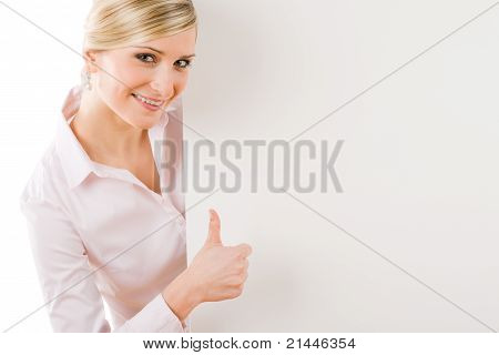 Happy Businesswoman Behind Empty Banner Thumbs Up