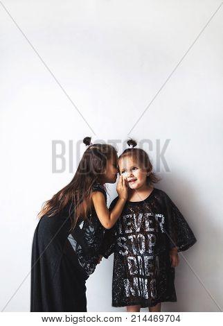 portrait of two gossiping girls portrait of two gossiping girls