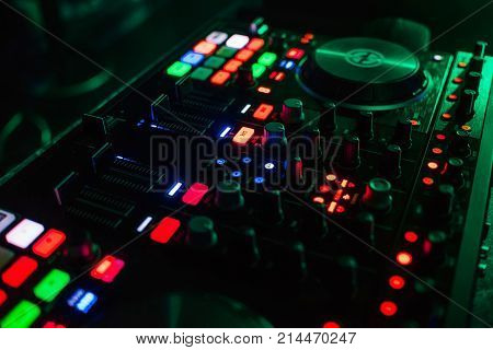 backlit buttons on a modern Board of management of the music for the DJ with different colors