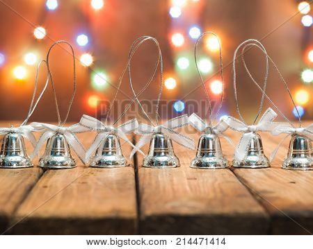 Christmas bells on bright bokeh background, festive background