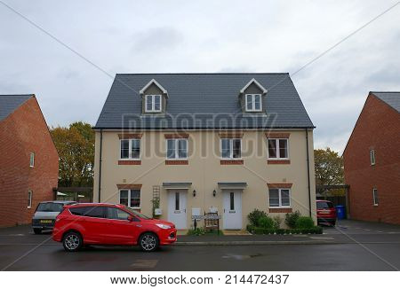 Bracknell, England - Nov 20, 2017: Front view of semi-detached modern homes with cars outside on a new housing estate in Bracknell, England