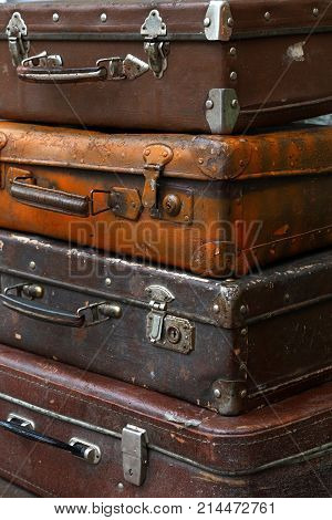 Stack Of Old Vintage Travel Suitcases Close Up