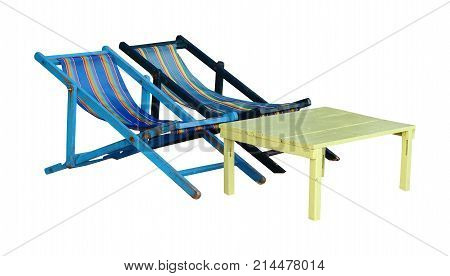 Colorful deck chair and yellow table isolated on white background with clipping path. Two deck chairs and one table on white pattern.