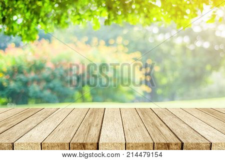 Empty wooden table over blur nature park outdoor background blank tabletop design for product display montage template