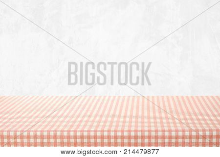 Empty table cover with pink and white tablecloth over white cement wall background banner table top counter design for food and product display montage