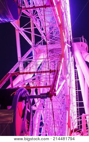 Ferris wheel decoration light at the city at nigth