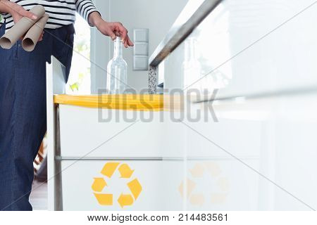 Housewife Throwing Glass Bottle