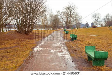 Early spring park at cloud day Russia.
