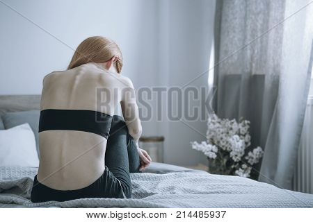 Woman With Anorexia On Bed