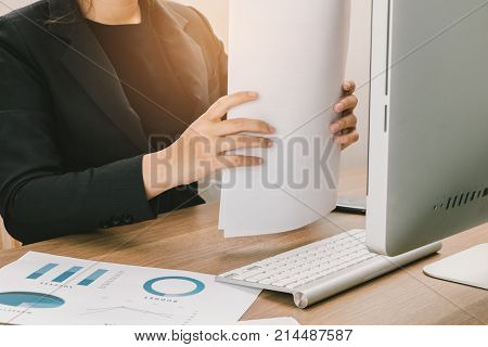 Asia Business Woman Working With Finance Documents On Her Desk, Business Concept