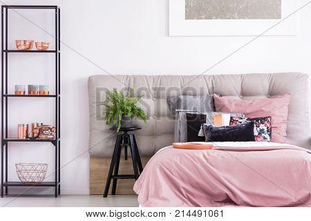 Bedroom With Black Metal Rack
