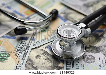 Medical Stethoscope And Dollar Bills