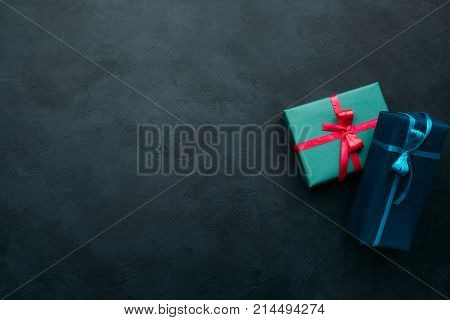 Two gift boxes on dark background. Problem of choosing a perfect gift for a man. A worthy reward concept