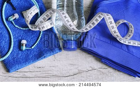 Sports dumbbells sneakers sports shoes and clothes. Women's items for sports life. Measuring tape, centimeter. The concept of sport for weight loss.