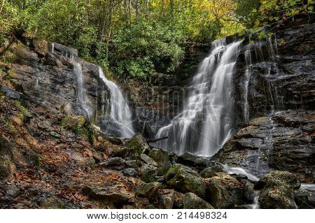 Soco Falls is a scenic 50 foot double waterfall not far from the Blue Ridge Parkway in North Carolina on US 19. Seen here in autumn.