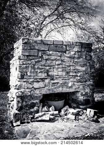Large hewn brick outdoor fireplace used for cooking by early Pioneers