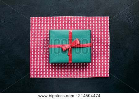 cute gift for beloved people on dark background. bright present wrapping. great surprise for birthday, fathers day, valentines day, new year, christmas, thanksgiving and other holidays.