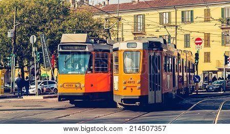 Two  Old Tram Line 12 Of The Company Azienda Trasporti Milanesi Circulating In Milan
