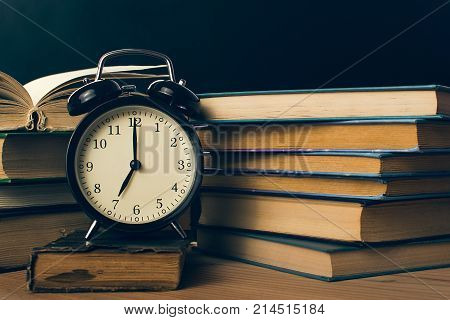 concept books and alarm clock vintage image