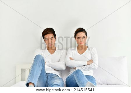 A couple lover is upset about something in the bedroom.