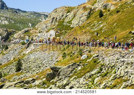 Col de la Croix de Fer France - 25 July 2015: Spectators waiting for the peloton during the passing of The Publicity Caravan on the roadside to the Col de la Croix de Fer in Alps during the stage 20 of Le Tour de France 2015.