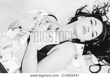 Lying woman under blanket under red blanket. Black and white photography