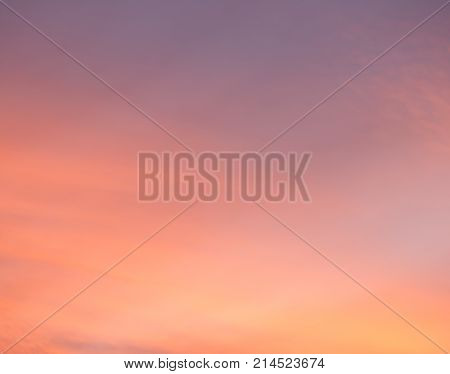 Dramatic sunset sky with warm colors in magenta orange yellow and pink
