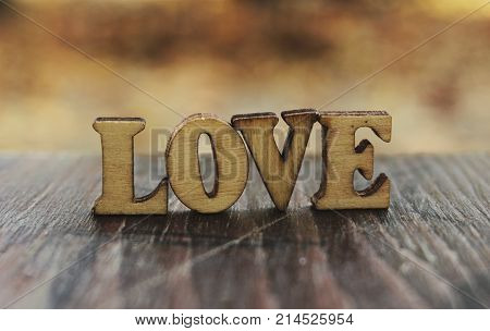 Love word letters. Love wood letters on table. Love wood letters close up. Photo stock.
