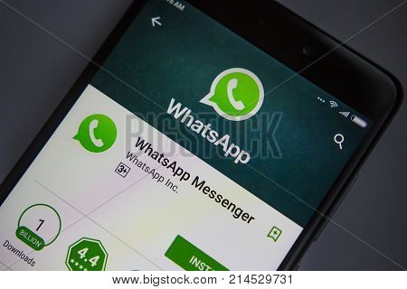 Berlin Germany - November 19 2017: WhatsApp application on screen of modern smartphone close-up. Install menu of WhatsApp app in Play Store. Apps icon of Messenger