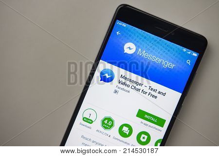 Berlin Germany - November 19 2017: Facebook Messenger application on screen of modern smartphone close-up. Install menu of Messenger app in Play Store. Apps icon of Messenger.