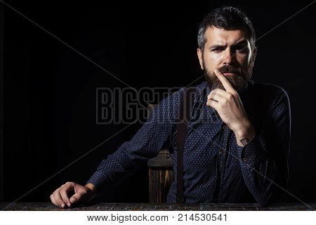 Fashion and beauty. Business and success. Man in formal outfit isolated on black background. Businessman or ceo at table. Manager with beard on serious face. copy space