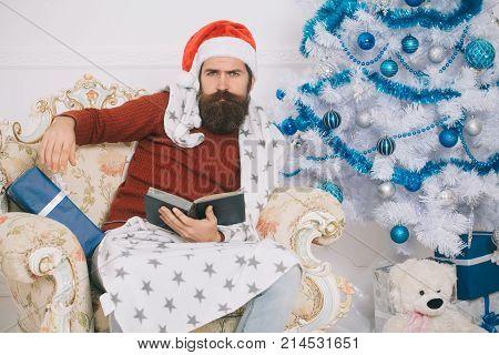 New Year Guy At Blue Christmas Tree.