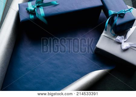expensive luxury present for rich men on dark background. professional gift wrapping. worthy surprise for bithday, fathers day, valentines day, new year, christmas, thanksgiving and other holidays.