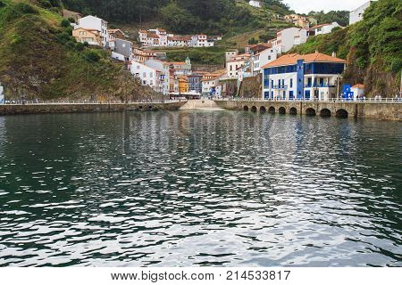 View from water to Cudillero, small fishing village in Asturias, Spain.