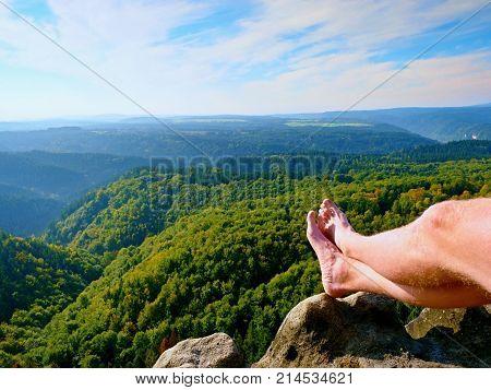 Naked Male Sweaty Legs On Peak Of Rock Above Valley.  The End Of Trek