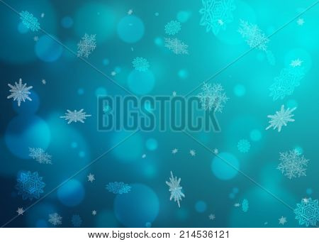 Beautiful blue winter blurred background. Snowflakes flying in the air. Snowflakes winter New Year Christmas theme. Snow christmas snowflake background snowflake winter. Silver snowflake.