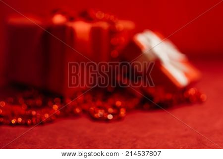romantic holiday red defocused background. present for beloved on birthday, christmas, new year, thanksgiving, valentines day and other holidays. color of passion