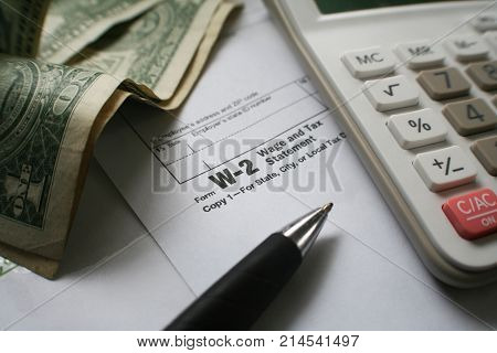 W-2 Tax Form With Money & Calculator