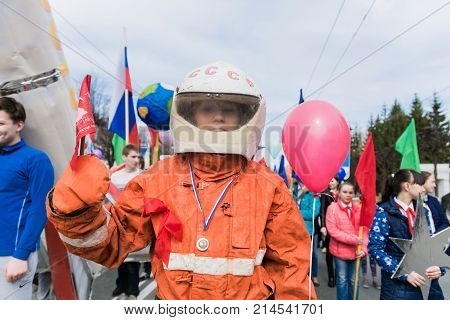 Yoshkar-Ola, Russia - May 1, 2016 Participant in the May Day demonstration student of the College of Culture and Arts disguised as a spacesuit of the Soviet cosmonaut