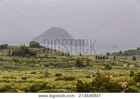 view of the bay of laganas and the island of marathonisi from the interior of zakynthos a cloudy day