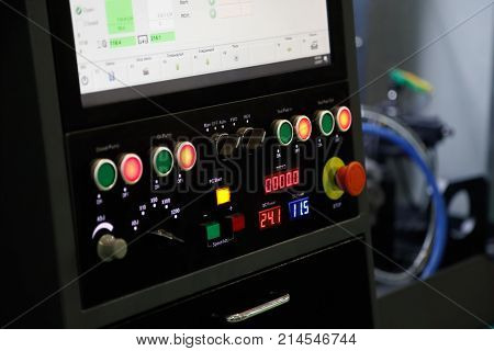 Controls of the industrial CNC machine. Selective focus.