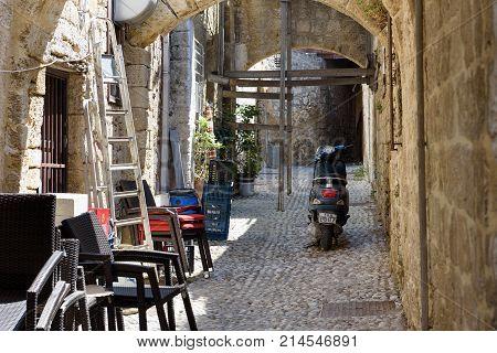 RHODES, GREECE - AUGUST 2017: Narrow street of Rhodes town on Rhodes island, Greece