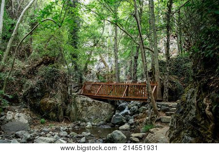 A small wooden bridge over a stream on a way to Caledonia waterfall near Platres central Cyprus