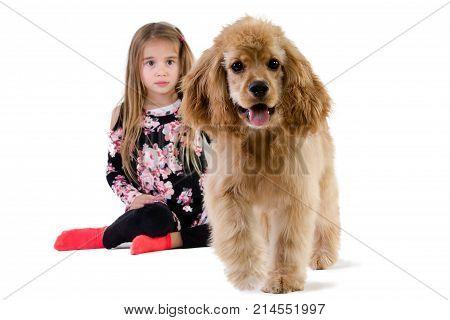 Young Girl Watching Her Dog Walking Away